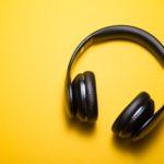 flatlay photography of wireless headphones