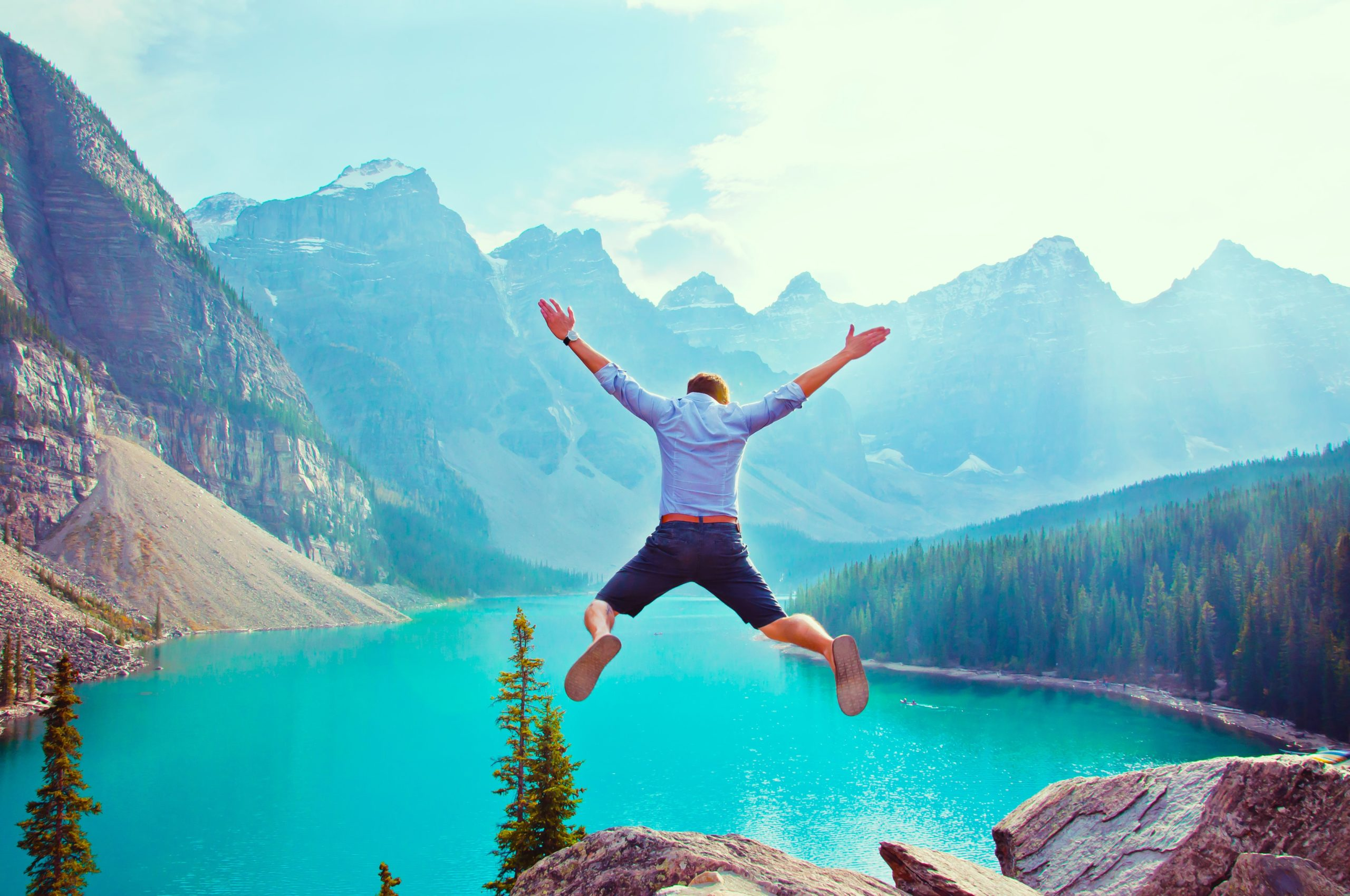 photo of man about to jump from cliff